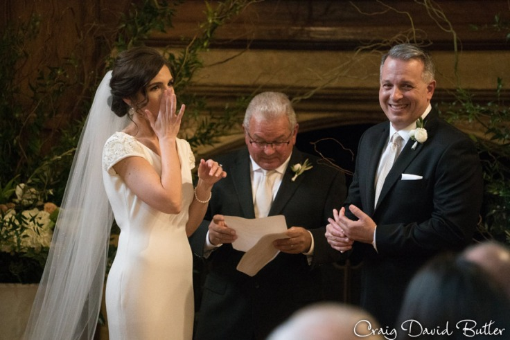 reaction photo of bride and groom during vows.