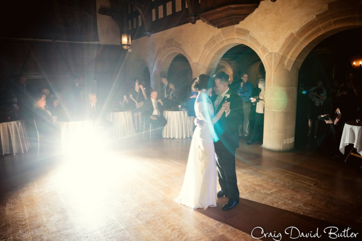 Back lit photo of bride and groom during their first dance.