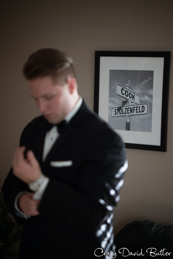 Groom portrait with Sign of bride and grooms names.
