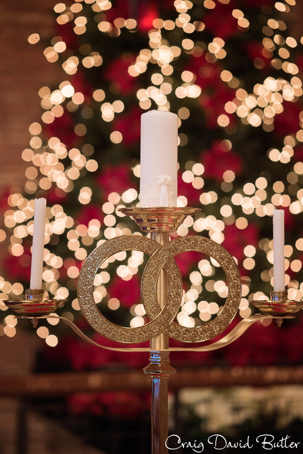 bride and groom's unity candle with Christmas Tree behind