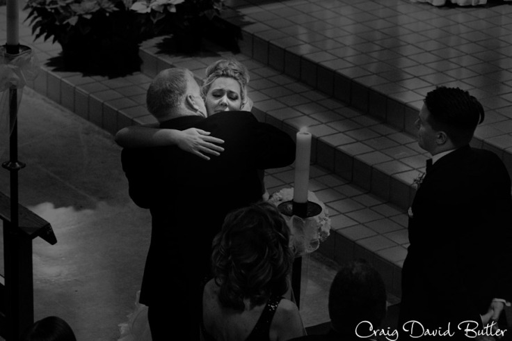 Bride and dad hug before giving her away.