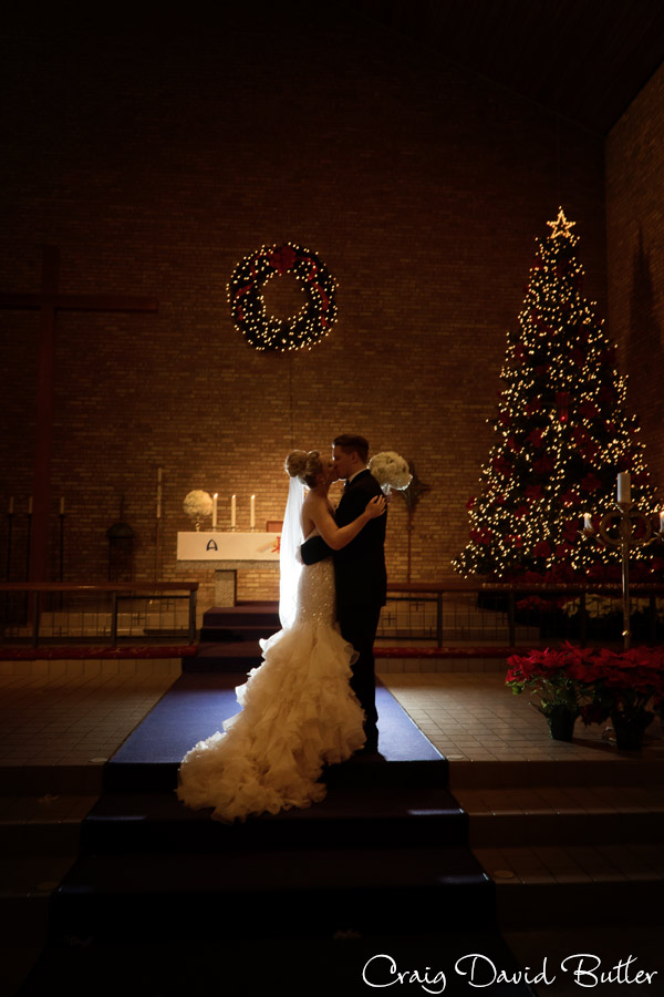 backlit photo of the bride and groom at Our Shepard in Birmingham MI