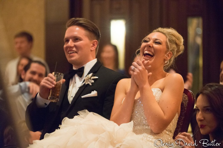 Shannon & Nathan watching the same day edit video at the reception.