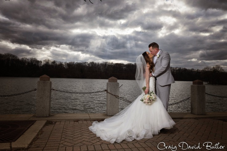 Photo of Bride & Groom with dramatic Sky