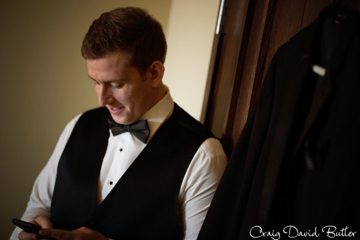 groom texting bride during wedding day