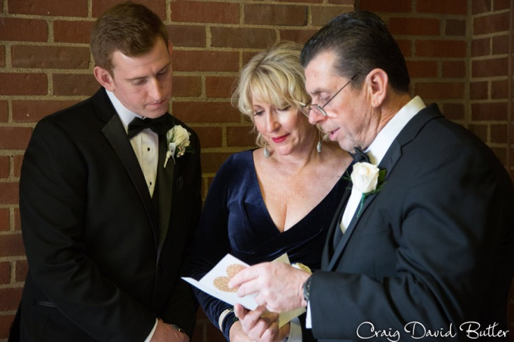 groom gives the note to his parents on the wedding day