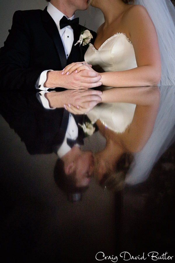 bride and groom using reflection of the table
