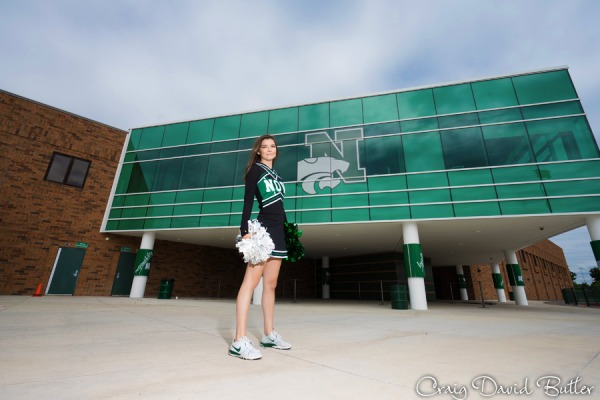 Senior Photo of Danielle in front of Novi High School logo