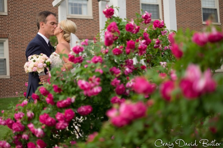 Bride & Groom around the flowers at the Dearborn Inn
