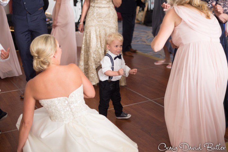 cute photo of the ring bearer on the Dance floor at the dearborn Inn