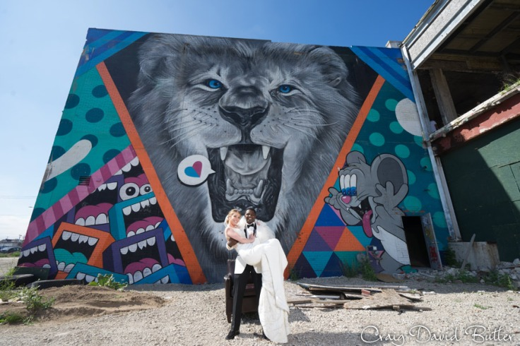 Bride & Groom in front of the Lion Mural in Eastern Market Detroit
