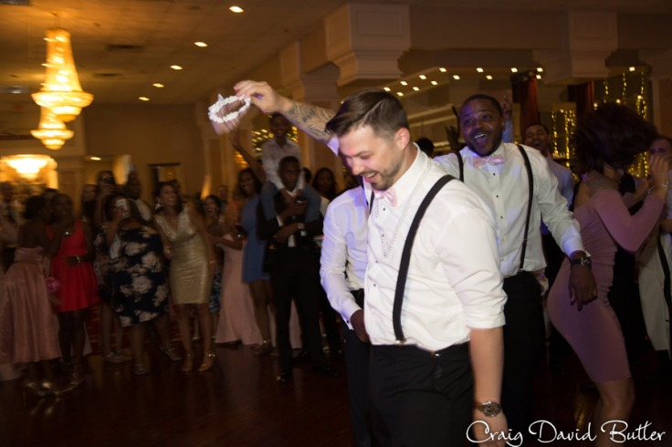 Best Man catches the garter during the toss at Enchantment
