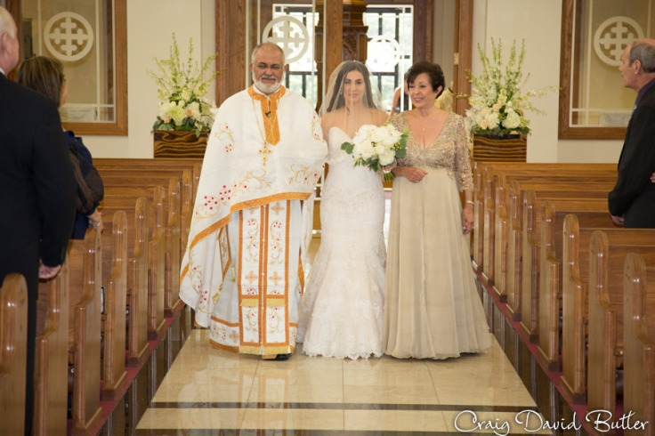 Bride and her parents during the processional at Basilica of St. Mary in Livonia