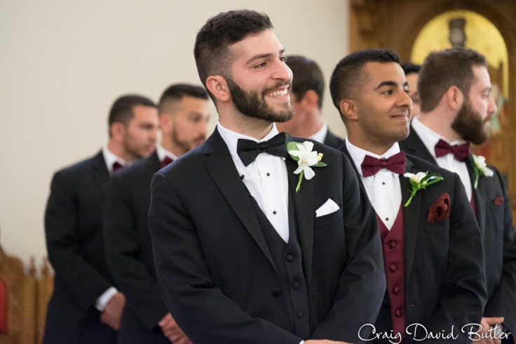 Groom waiting for bride during the processional at Basilica of St. Mary in Livonia by Craig David Butler