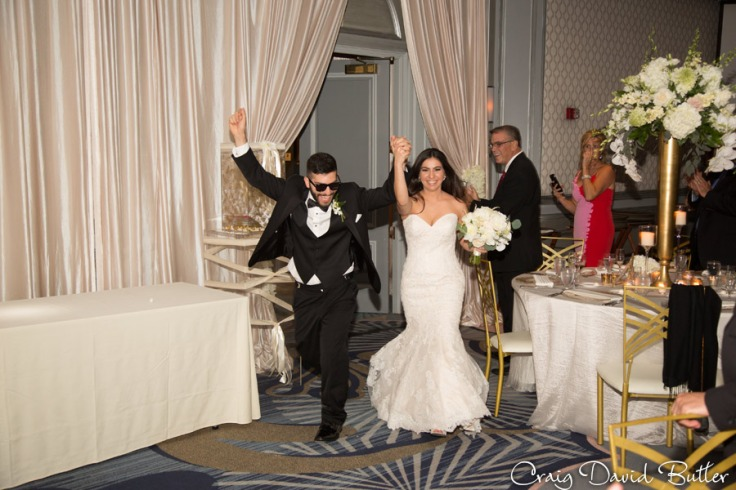 Georgie & Andrew's grand entrance The Henry Wedding reception in Dearborn by Craig David Butler
