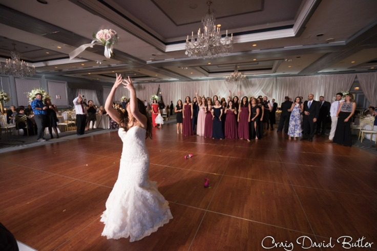 Bride's bouquet toss The Henry Wedding reception in Dearborn by Craig David Butler