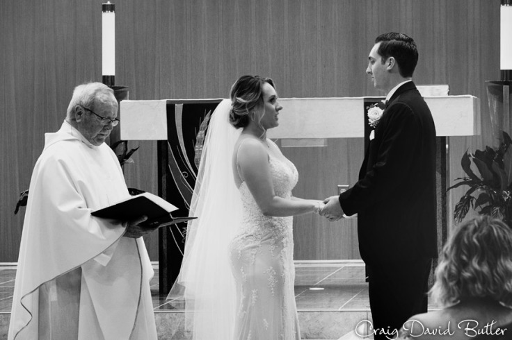 Vows during the ceremony at St. John Neumann