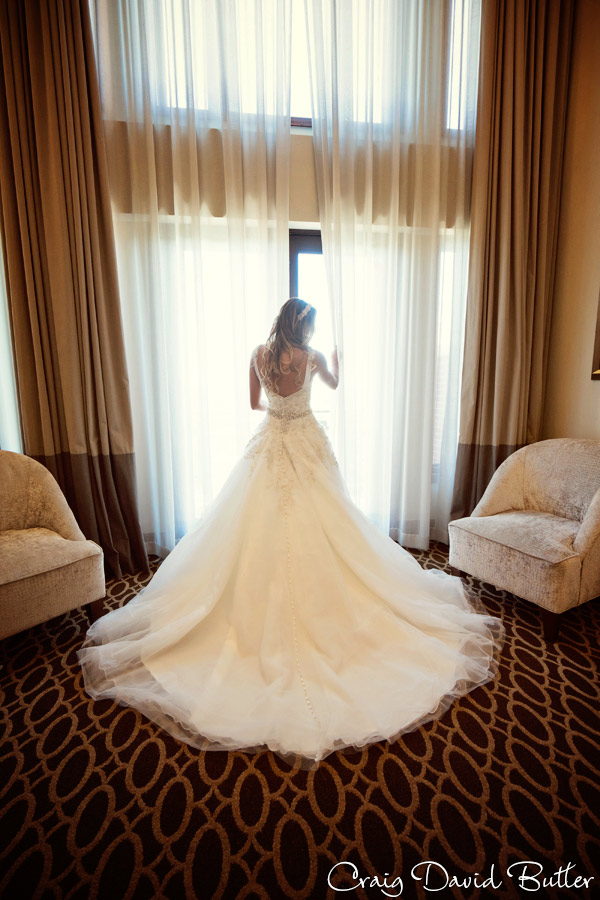 Bride at the Window in the Suite