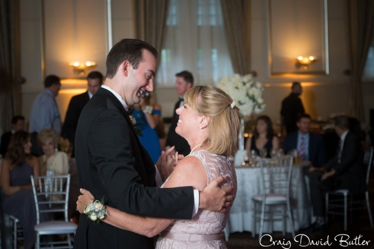 Groom and Mother during their first dance in the grand Ballroom at the Inn at St. John's in Plymouth MI by Craig David Butler