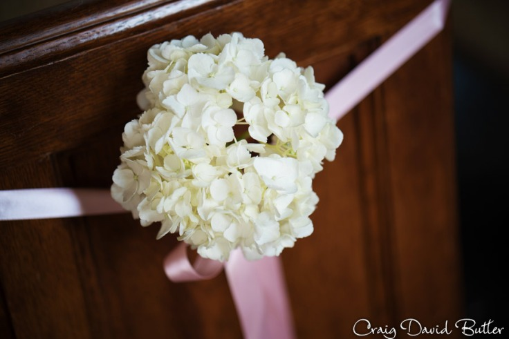Pew Wedding Decorations at First United Methodist Church wedding in Ann Arbor by Craig David Butler