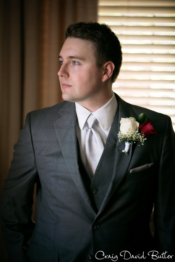 Portrait of groom at the wedding ceremony in First United Methodist Church in Ann Arbor, MI Craig David Butler