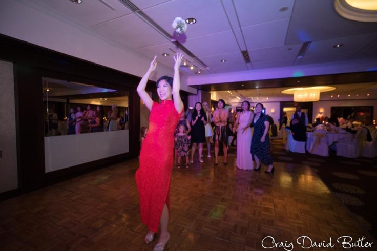 Bride tosses her bouquet