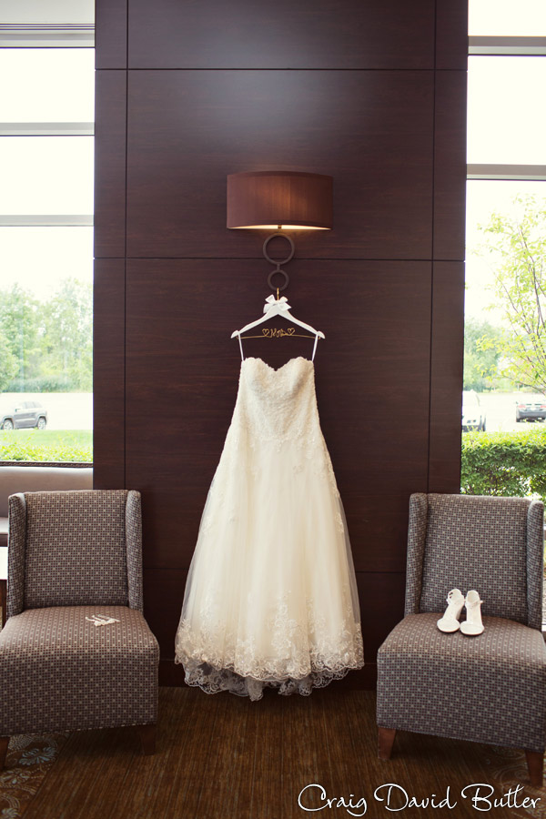Brides gown and shoes detail photo at Diamond Center in Novi