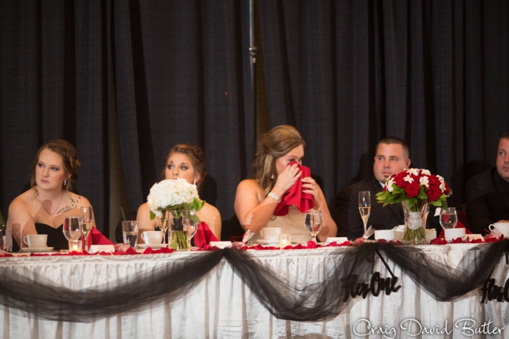 Brides reaction to the heartfelt speech from her dad at the wedding reception in the Diamond Center Novi MI
