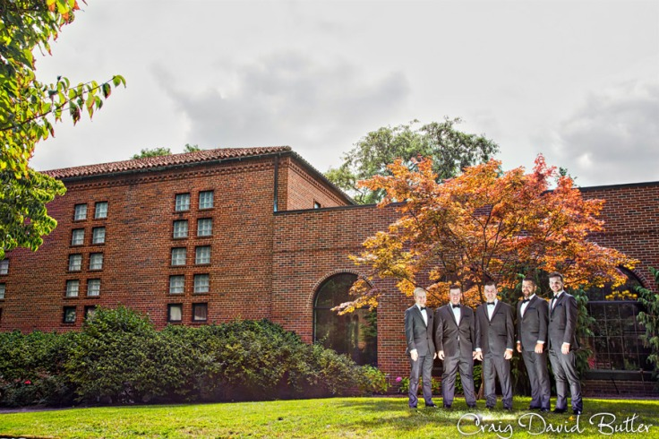 Architectural portrait fo the groom with the groomsmen at the Inn at St. Johns in Plymouth MI by Craig David Butler