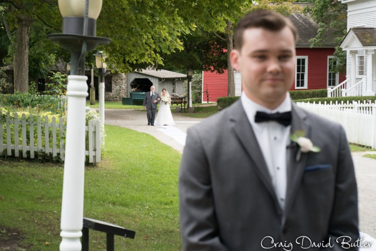 bride procession during ceremony at Mill Race Village in Northville MI by Craig David Butler
