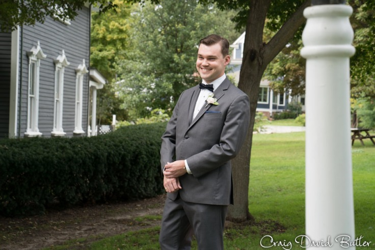 Grooms reaction to the bride at Mill Race Village in Northville MI by Craig David Butler