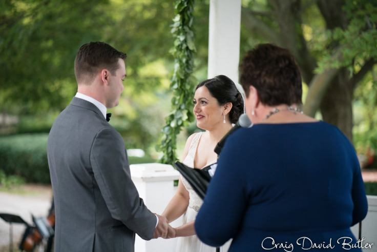 Wedding vows at Mill Race Village in Northville MI by Craig David Butler