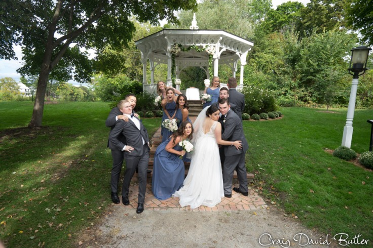 Wedding bridal party portraitat Mill Race Village in Northville MI by Craig David Butler
