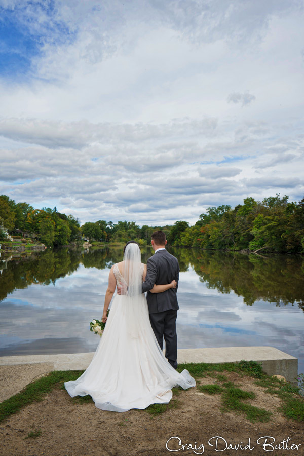 Bride and Groom portraitat Mill Race Village in Northville MI by Craig David Butler