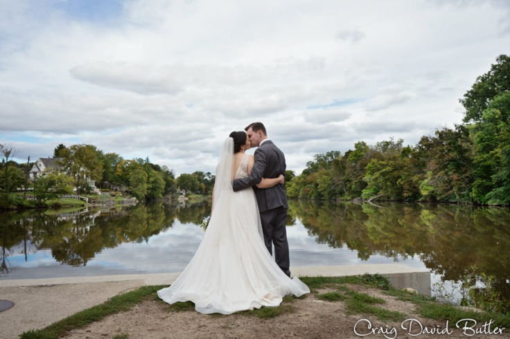 Bride and groom portrait at Mill Race Village in Northville MI by Craig David Butler