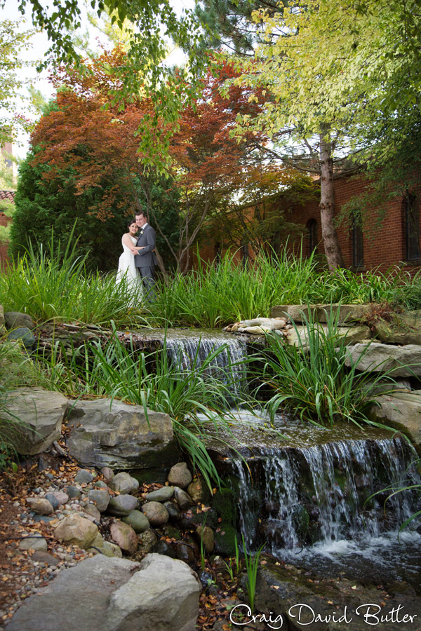 Bride and groom in the waterfall garden at st. Johns