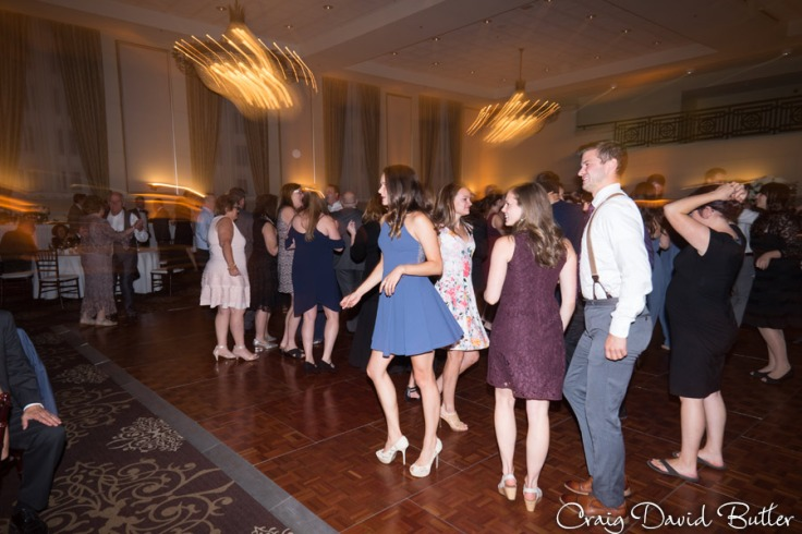 Dancing at the wedding reception in the Grand Ballroom at the Inn at St. John's in Plymouth MI by Craig David Butler