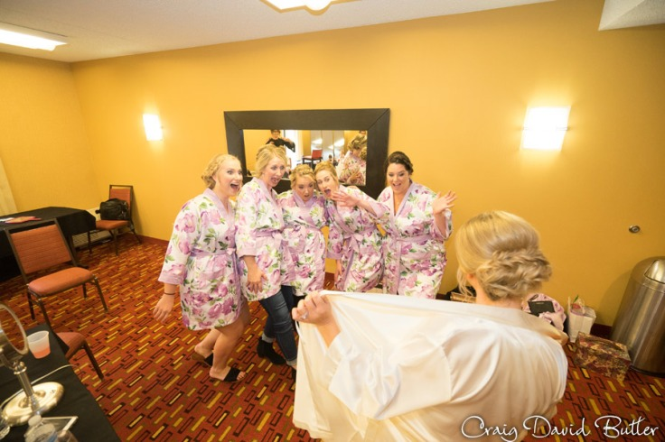 Fun photo with Bride flashing her bridesmaids at the Courtyard by Marriott in Livonia MI