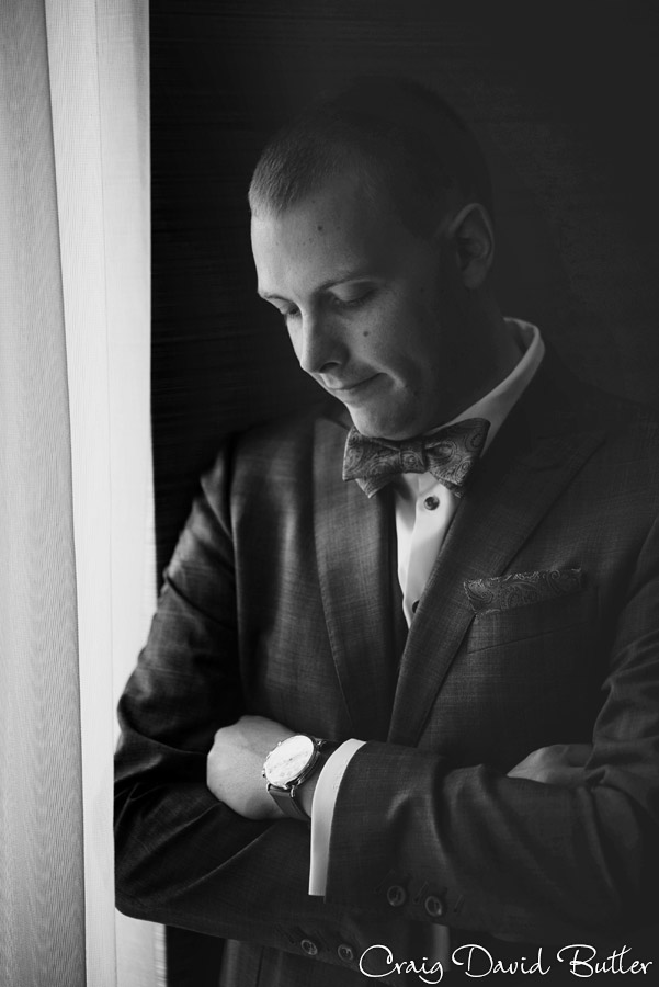 Groom's natural light portrait at the Marriott Laurel Park MI