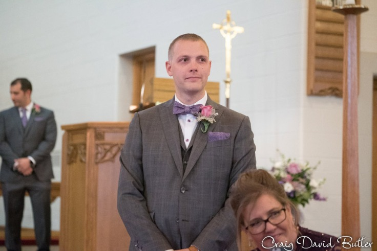Grooms reaction to brides entrance during the wedding processional