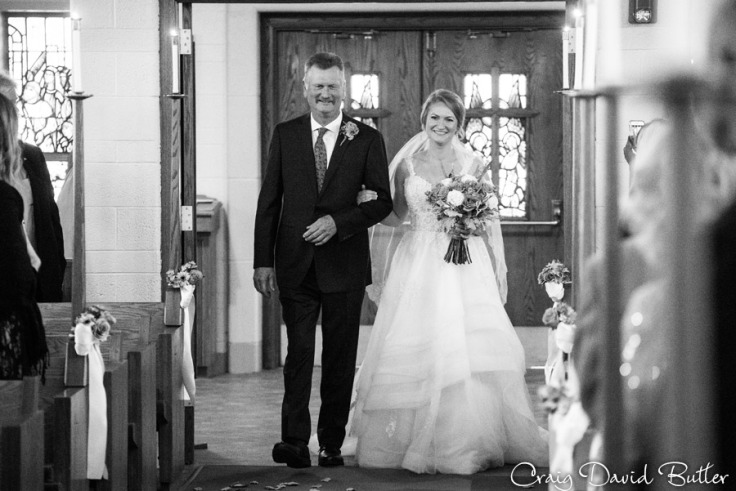 Trisha and her father during the processional at Emmanuel Lutheran Church in Dearborn