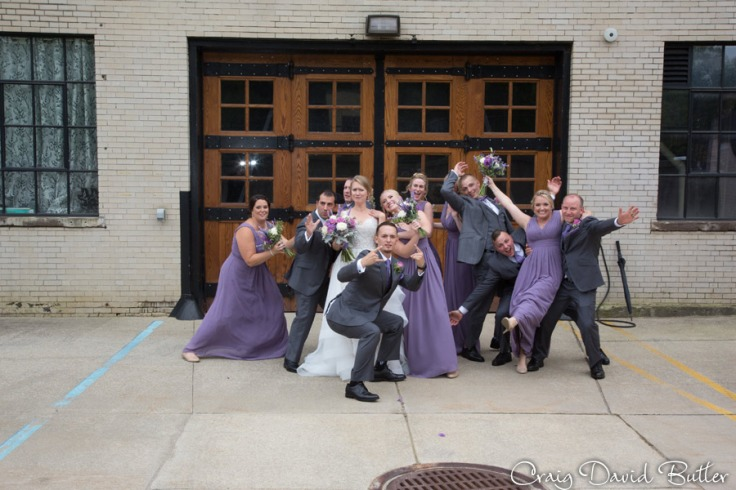 Fun photo of the bridal party behind the waterwheel in Northville MI