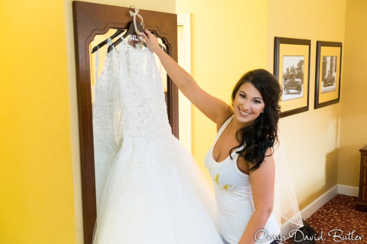 Bride reaching for her gown at the Dearborn INN