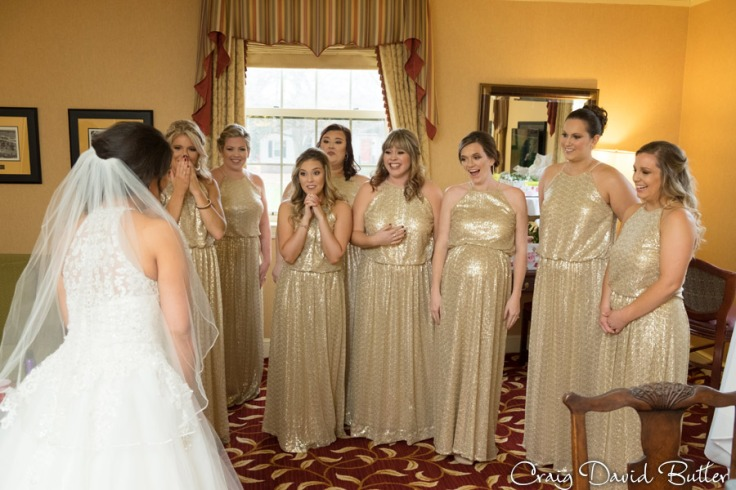 Bridesmaids see the bride for the first time