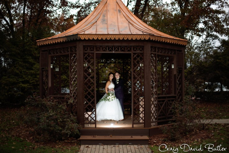 Bride & Groom in the Gazebo with remote flash at the Dearborn Inn