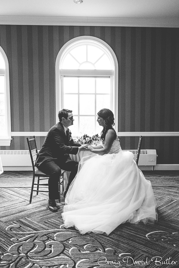 Bride and groom have a moment at the Dearborn Inn during their wedding day