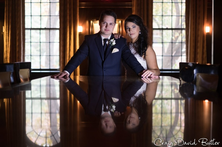 Bride and groom Cool photos in the bar at the Dearborn Inn