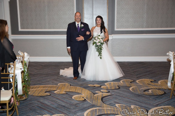 bride coming down the aisle with her father at the Dearborn Inn in Dearborn MI