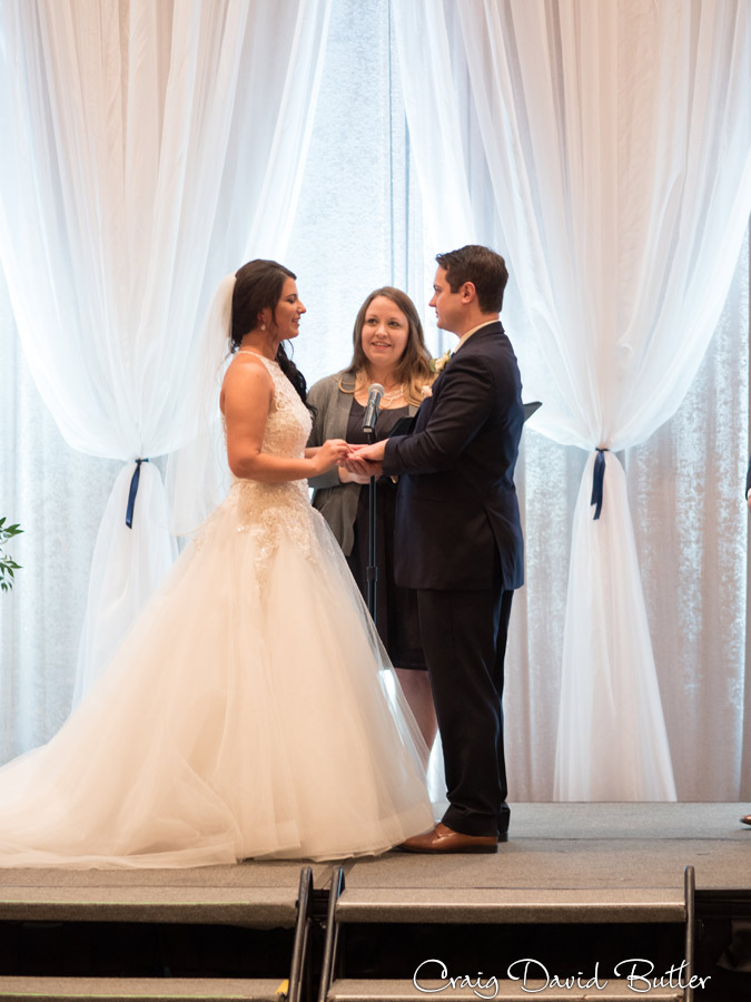 Wedding ceremony at the dearborn inn with the exchange of rings